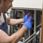 sanitary-technician-working-with-pipes_23-2147772240